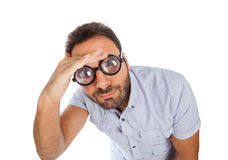 Man with a surprised expression and thick glasses Royalty Free Stock Photos