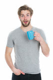 Man or surprised guy drink from coffee or tea cup Stock Photography