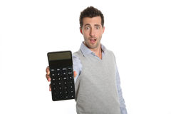 Man with surprised look holding a calculator Royalty Free Stock Photo