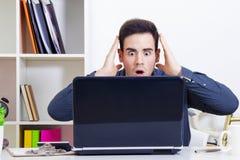 Man surprised looking computer Stock Photo