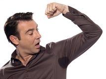 Man surprised looking at sweat stain perspiring Stock Photo