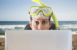Man surprised by the offers on the beach Royalty Free Stock Images