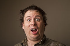 Man surprised at seeing something. Shocked or surprised expression on a young mans face Stock Photo