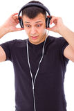 Man surprised by something unexpected on headphones Stock Photos