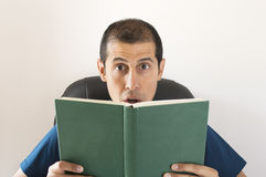 Man surprised by what you are reading Royalty Free Stock Photography