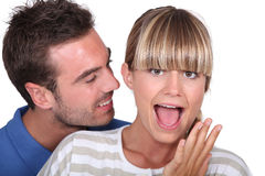 Man surprising his girlfriend Royalty Free Stock Photography