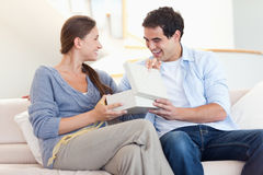 Man surprising his wife with a present Stock Images