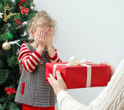 Man surprising little girl. With christmas gift Royalty Free Stock Image