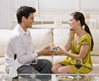 Man surprising wife with elegant gift stock image