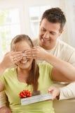 Man surprising woman Stock Images