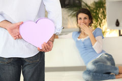 Man surprising woman with gift Stock Photography