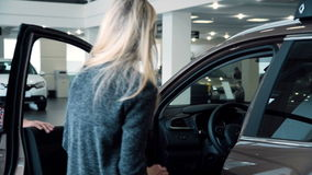 Man Surprising Woman with New Car In Show Room