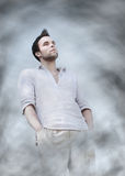 Man surrounded by clouds Royalty Free Stock Photography