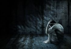 Man surrounded by darkness. Helpless man surrounded by darkness Royalty Free Stock Photos