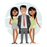 Man surrounded by two beautiful girls. Successful businessman in a suit, macho and handsome. Attractive guy on vacation. Stock Photos