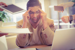 Man surrounding by work Royalty Free Stock Photography