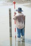 Man survey boundary of area Stock Photos