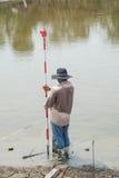 Man survey boundary of area Stock Photography