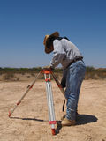 Man Surveying at Excavation Site - Vertical Stock Photo