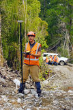 Surveyor at work. Man surveying the location of geophones for a seismic reflective survey on the West Coast of New Zealand Stock Photography
