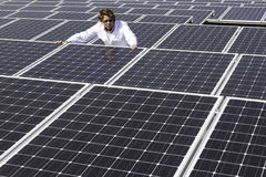 Man surveying solar panels Royalty Free Stock Photo