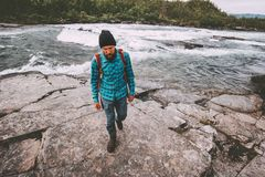 Man survival traveling hiking at river active healthy lifestyle stock photo