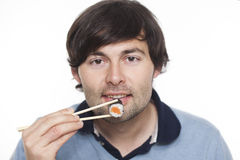 Man with sushi Royalty Free Stock Photos