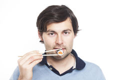 Man with sushi Stock Photography