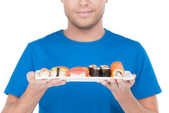 Man with sushi. Stock Photography