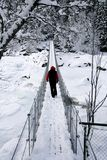 Man on suspension bridge Stock Photo