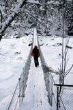 Man on suspension bridge stock photo