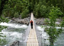 Man on a suspension bridge Royalty Free Stock Image