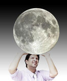 Man sustaining the moon (image of the moon is from NASA) Royalty Free Stock Photo