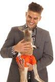 Man in sut hold kangaroo in shorts Royalty Free Stock Image