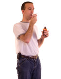 Man Swallowing Medicine Stock Photo