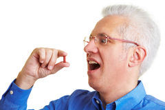 Man swallowing red pill Stock Photos