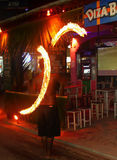The man sways fire. Fire swinging show which is popular performance of islander in Thailand. It could advert of tourists to stop and look at the show. In the Royalty Free Stock Image