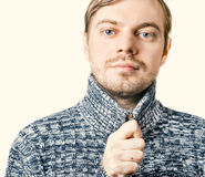 Man in sweater. Portrait of a man in sweater. Isolated. Color toned Stock Image