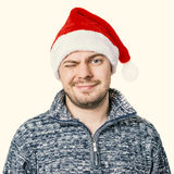 Man in sweater. Portrait of a man in sweater with red Santa hat. Color toned. Isolated Royalty Free Stock Images