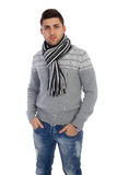 Man in sweater on white background. Casual handsome man smiling at camera, hands in pocket royalty free stock photos