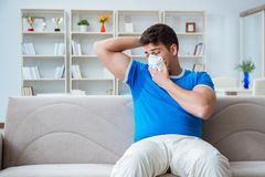 The man sweating excessively smelling bad at home. Man sweating excessively smelling bad at home Stock Photos