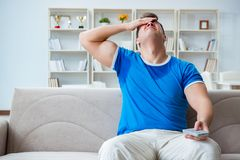 The man sweating excessively smelling bad at home. Man sweating excessively smelling bad at home Stock Images