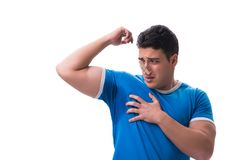 Man sweating excessively smelling bad isolated on white backgrou. Nd stock photo