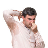 Man with sweating under armpit pinches nose with fingers. Isolated on white Royalty Free Stock Image