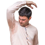 Man with sweating under armpit in pink shirt isolated on white. Young man with sweating under armpit in pink shirt isolated on white Royalty Free Stock Photos