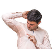 Man with sweating under armpit in pink shirt isolated on white. Young man with sweating under armpit in pink shirt isolated on white Stock Photo