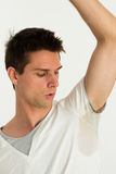 Man sweating very badly under armpit and looking t. Here Royalty Free Stock Image