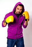A Man in sweatshirt with yellow boxing gloves royalty free stock photography