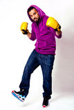 A Man in sweatshirt with yellow boxing gloves stock images