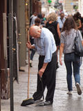 Man sweeping floor in front of shop in Naples Stock Photos